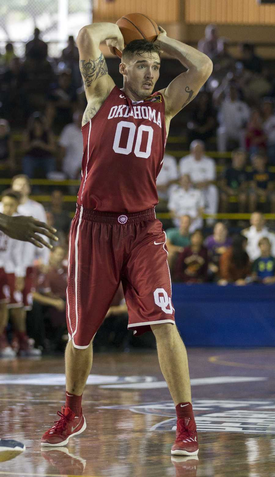 Oklahoma forward Ryan Spangler looks for an open teammate to pass to while playing against Villanova in the first half of an NCAA college basketball game at the Pearl Harbor Invitational on Monday, Dec. 7, 2015, in Honolulu.