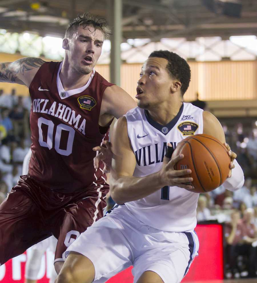Villanova guard Jalen Brunson (1) looks for an open shot while being defended by Oklahoma forward Ryan Spangler (00) in the second half of an NCAA college basketball game at the Pearl Harbor Invitational on Monday, Dec. 7, 2015, in Honolulu. Oklahoma defeated Villanova 78-55.