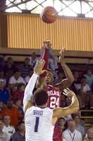 Oklahoma guard Buddy Hield (24) takes a three-point shot over Villanova guard Jalen Brunson (1) in the first half of an NCAA college basketball game at the Pearl Harbor Invitational on Monday, Dec. 7, 2015, in Honolulu.