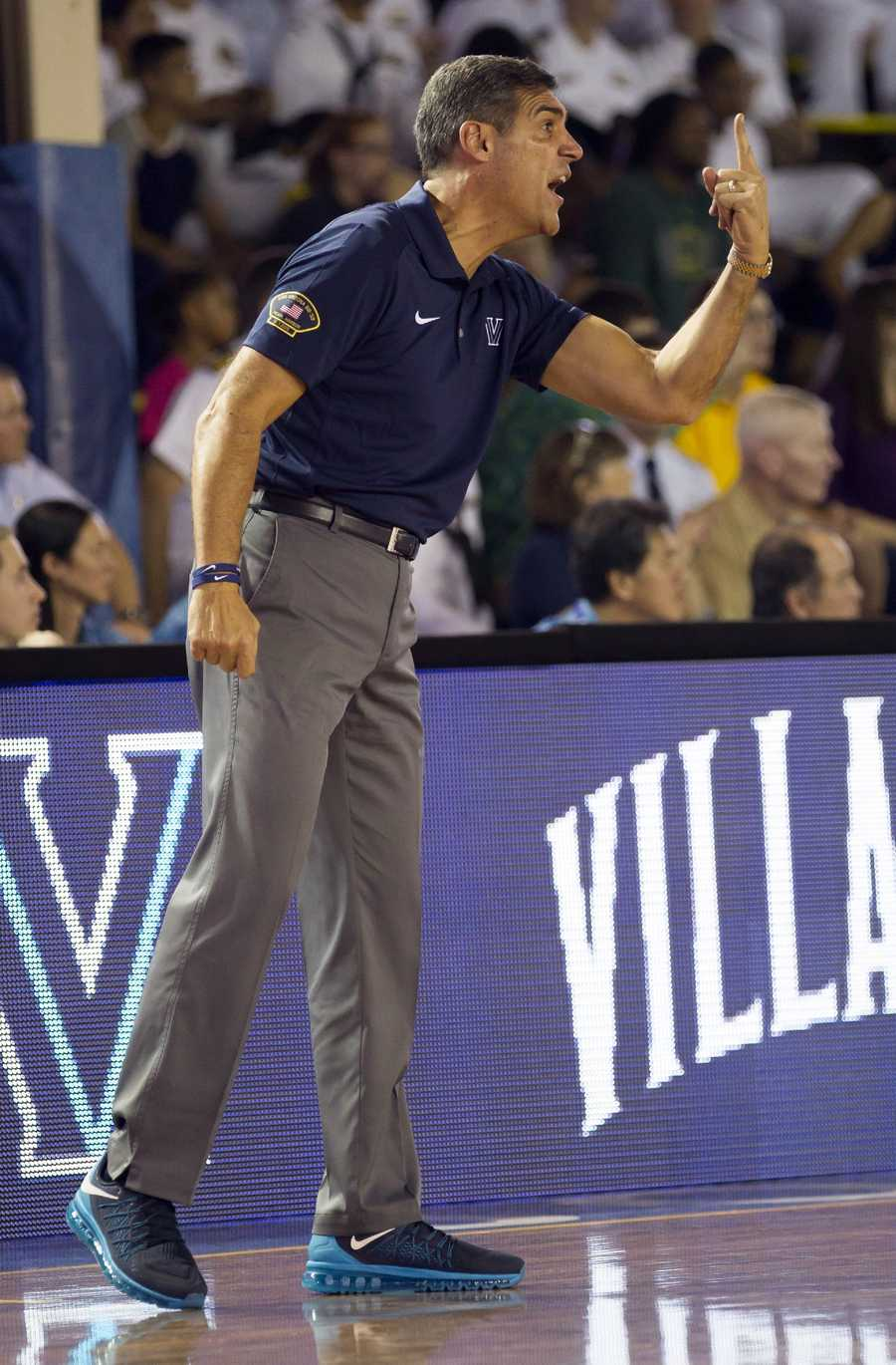 Villanova head coach Jay Wright calls a play as his team takes on Oklahoma in the first half of an NCAA college basketball game at the Pearl Harbor Invitational on Monday, Dec. 7, 2015, in Honolulu.