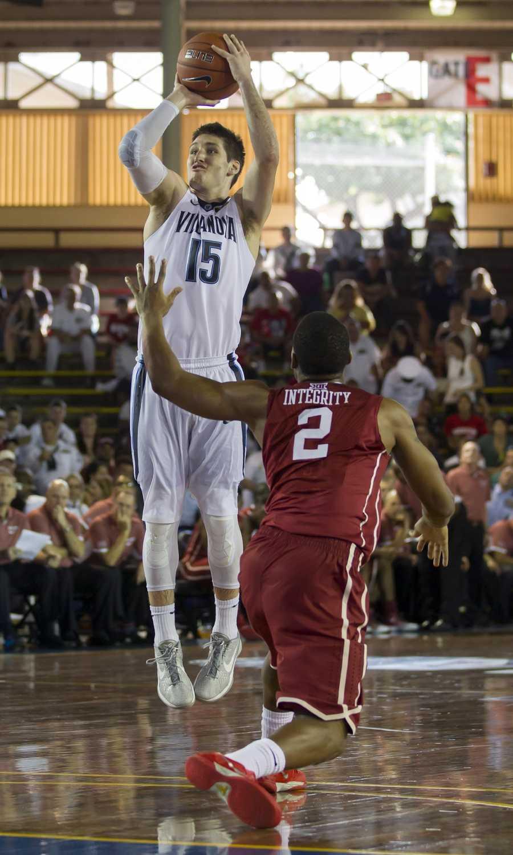 Villanova guard Ryan Arcidiacono (15) takes a jump shot over Oklahoma guard Dinjiyl Walker (2) in the second half of an NCAA college basketball game at the Pearl Harbor Invitational on Monday, Dec. 7, 2015, in Honolulu. Oklahoma beat Villanova 78-55.