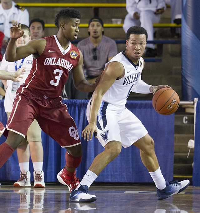 Villanova guard Jalen Brunson (1) looks to post up against Oklahoma guard Christian James (3) in the first half of an NCAA college basketball game at the Pearl Harbor Invitational on Monday, Dec. 7, 2015, in Honolulu.