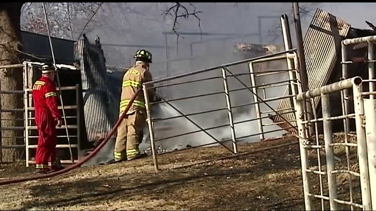 Crews battled a grass fire that was made complicated by strong wind Sunday afternoon near a woman's barn on Southeast 104th Street.