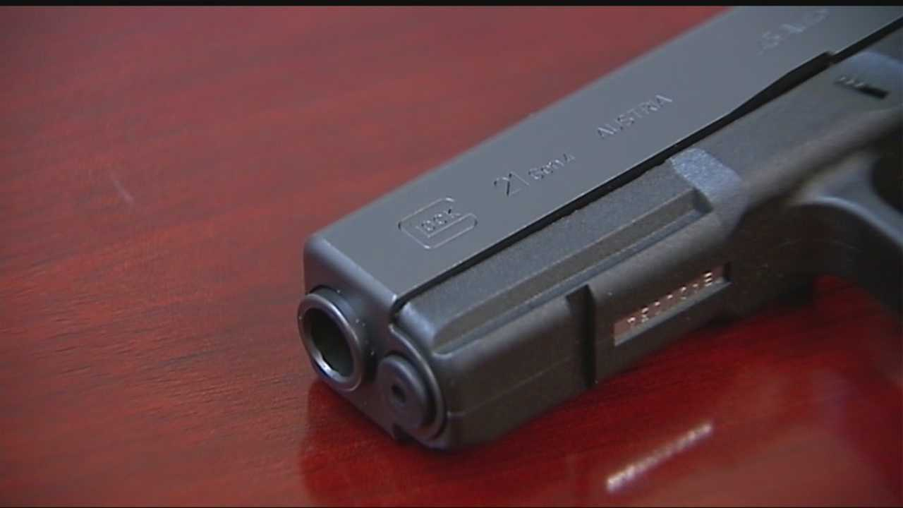 Authorities are investigating after metro police officers were accused of pawning guns.
