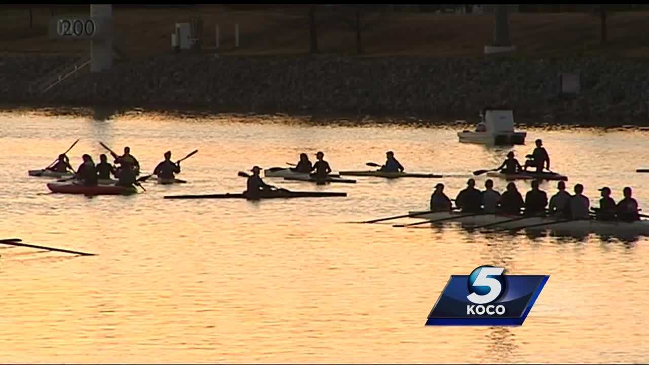 People gathered along the Oklahoma River early Saturday morning for a paddle-out ceremony to remember the late Aubrey McClendon.