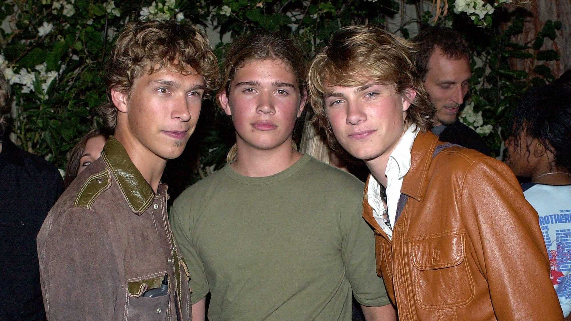 Members of the band Hanson, Isaac Hanson, left, and brothers Zachary and Taylor pose at a party in the Hollywood area of Los Angeles after hosting the MTV Movie Awards, Saturday, June 2, 2001. (AP Photo/Mark J. Terrill)