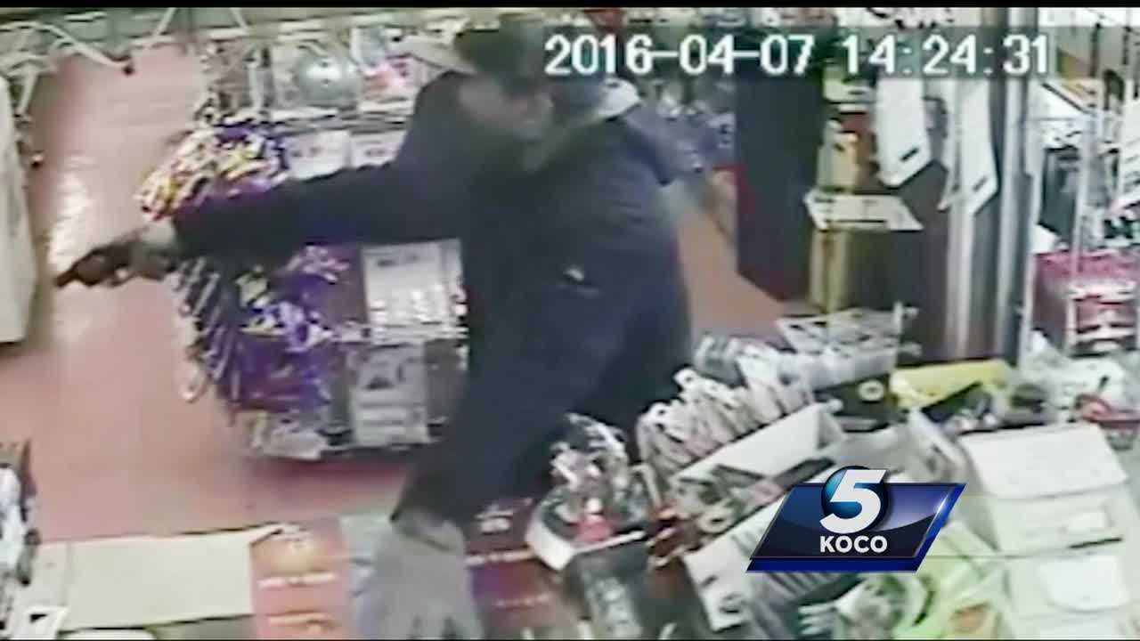 Two clerks were robbed at gunpoint in southeast Oklahoma City. The incident was caught on camera.