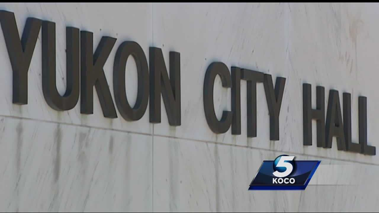About two dozen Yukon city employees are out of a job. The layoffs came amid the city's financial crisis.