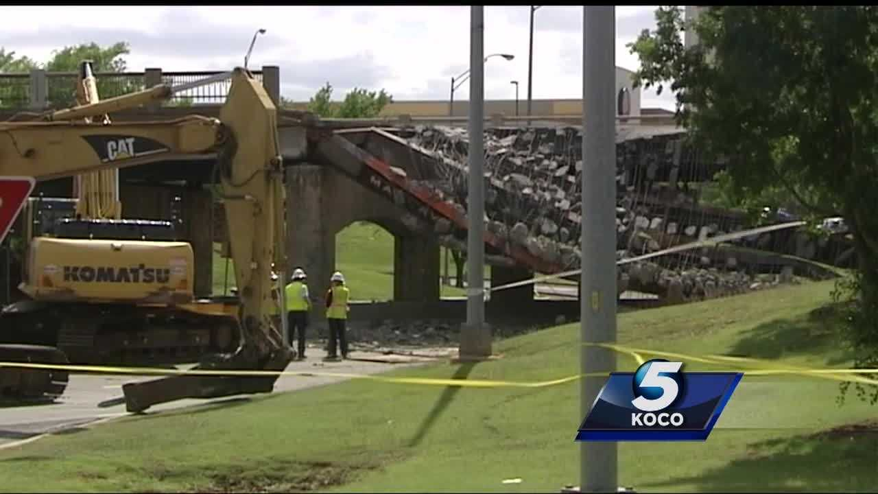 A portion of the May Avenue bridge over Northwest Expressway came crashing down Thursday. The damage has been removed, but prepare for a traffic mess.
