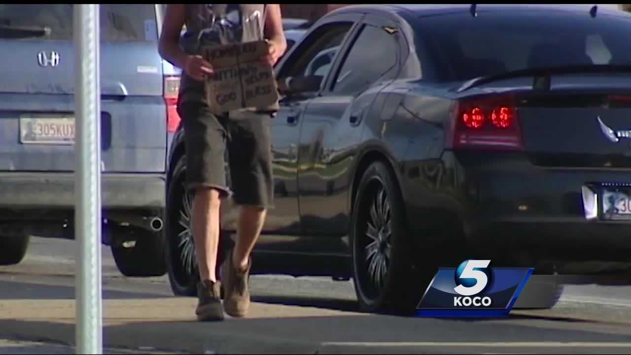 A woman was robbed at gunpoint last week by two panhandlers in southeast Oklahoma City. The woman was trying to give one of the panhandlers money when a man with a gun approached the car.