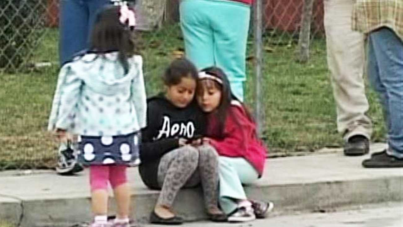 Kids were playing in their front yards when a drive-by shooting happened. (April 3, 2012)