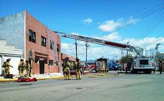 Firefighters said the blaze was caused by electrical wires in one of the upstairs apartments. Power was cut to the building while firefighters investigated. (April 4, 2012)