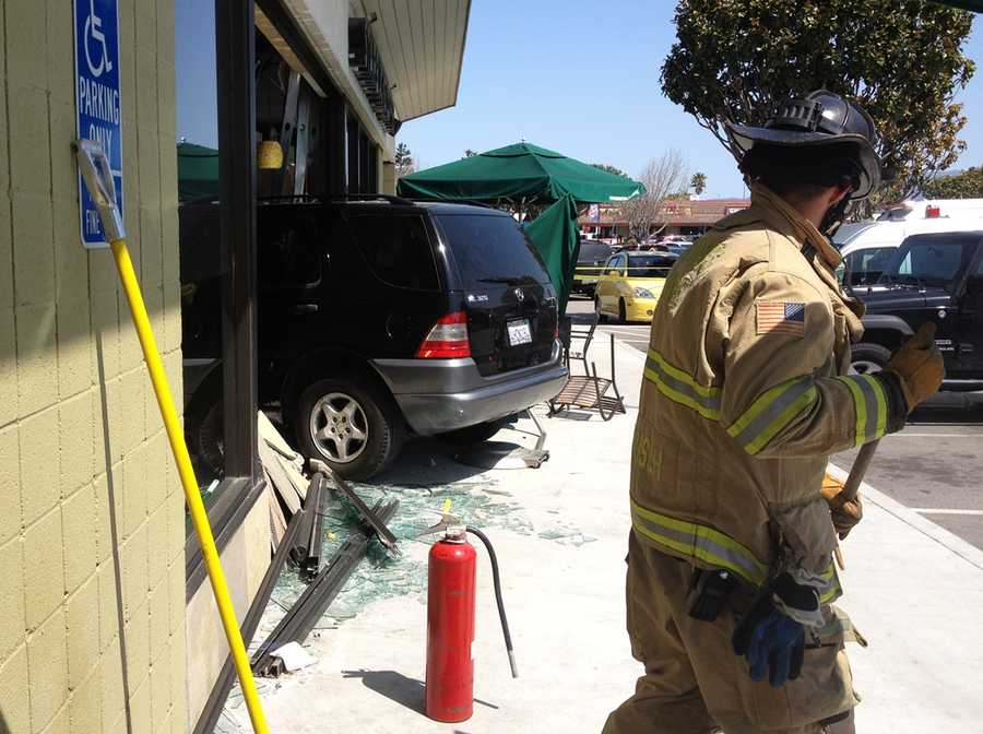 The SUV knocked over tables and chairs before it smashed through Starbucks' glass wall and drove into the building just before noon.(April 6, 2012)