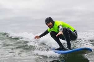 "Professional surfers volunteering for the 2012 Operation Surf include Darryl ""Flea"" Virostko (seen catching a wave here), Shawn ""Barney"" Barron, Richard Schmidt, Jimmy Herrick and Van Curaza."