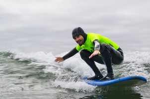 "Professional surfers volunteering for the 2012 Operation Surf include Darryl ""Flea"" Virostko (seen catching a wave here), Shawn ""Barney"" Barron, Richard Schmidt,Jimmy Herrick and Van Curaza."