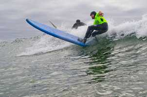 "Professional surfers volunteering for the 2012 Operation Surf include Darryl ""Flea"" Virostko, Shawn ""Barney"" Barron, Richard Schmidt, Jimmy Herrick and Van Curaza."
