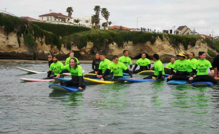 Professional surfers and wounded U.S. soldiers have fun at Cowell Beach during Operation Surf Santa Cruz 2012.