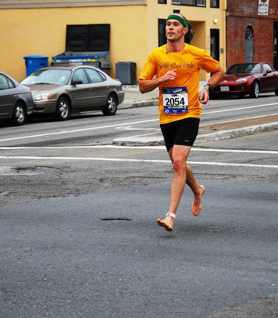 Tim Cunningham ran the marathon barefoot on Highway 1's asphalt. He ditched his shoes to raise awareness for children around the world who cannot afford to buy footwear.