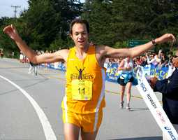 Adam Roach, 27, of Pacific Grove, crosses the finish line to win the Big Sur International Marathon with a finishing time of 2:22:30. (April 29, 2012)