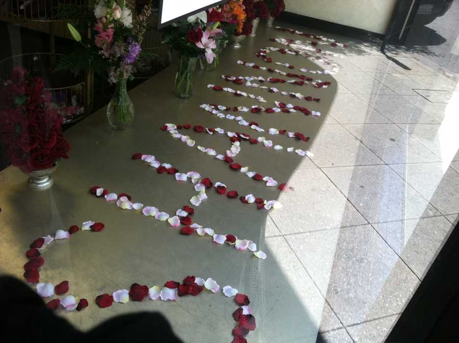 Several flower memorials made by her friends, family and community members.