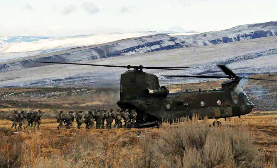 The Salinas soldier's brigade is seen last year filing onto a CH-47 Chinook helicopter of the 1st Battalion, 214th Aviation Regiment during an air assault training session in Yakima, Washington.
