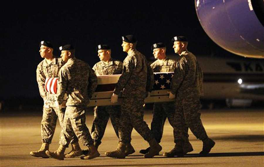 Vilmar Galarza Hernandez's remains are carried in a casket by a military color guard at Dover Air Force Vase in Delaware on May 27, 2012.