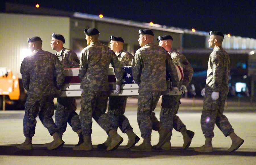 A U.S. Army carry team carries the remains of Army Spc. Vilmar Galarza Hernandez at Dover Air Force Base, Del., on May 27, 2012.  (Photo by U.S. Air Force)
