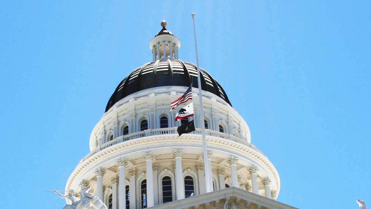 Flags at the State Capitol building are flown at half-staff in honor of Army Spc. Vilmar Galarza Hernandez. (June 6, 2012)