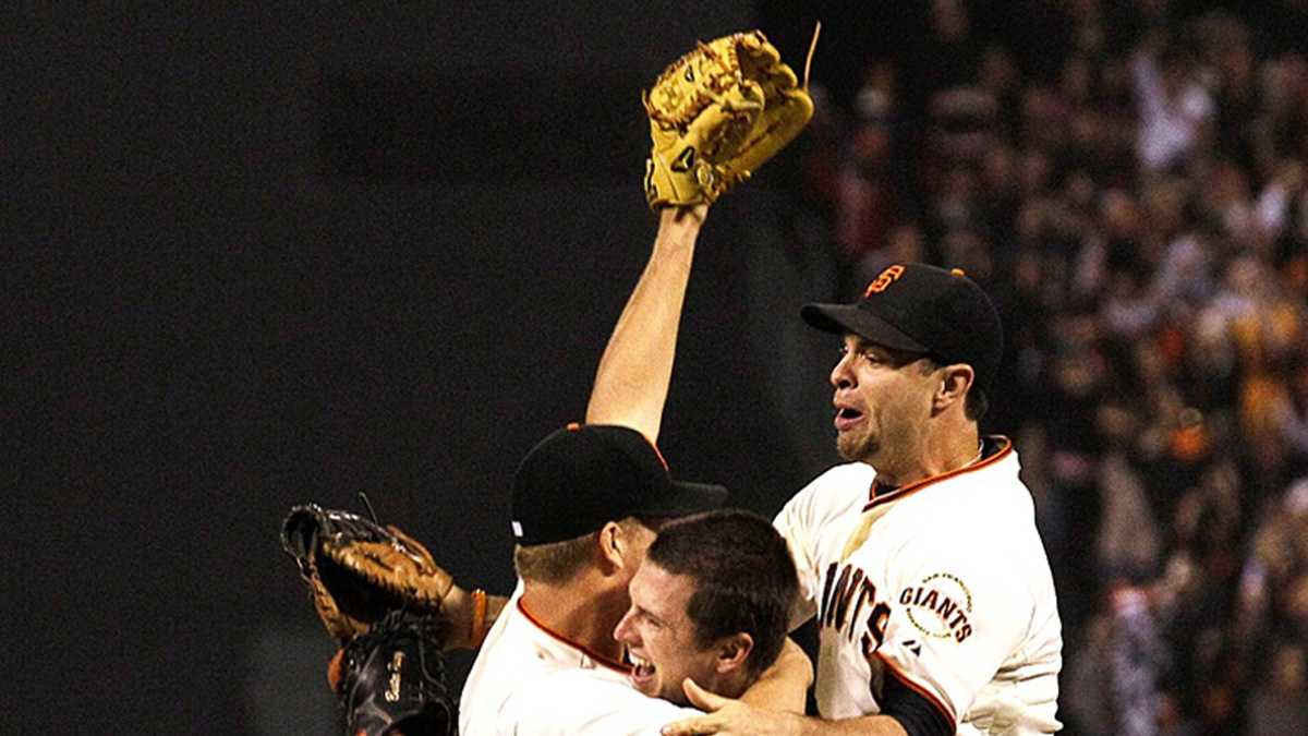 Matt Cain celebrates with Buster Posey Wednesday night. (AP Photo)