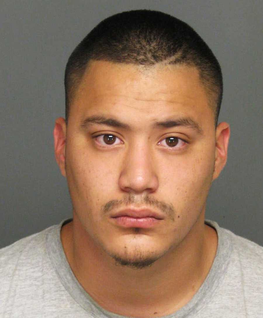 Ornelas and Martin Juarez, 23, of Fresno, (seen here),were booked into the Monterey County Jail on charges of theft and evading law enforcement officers.