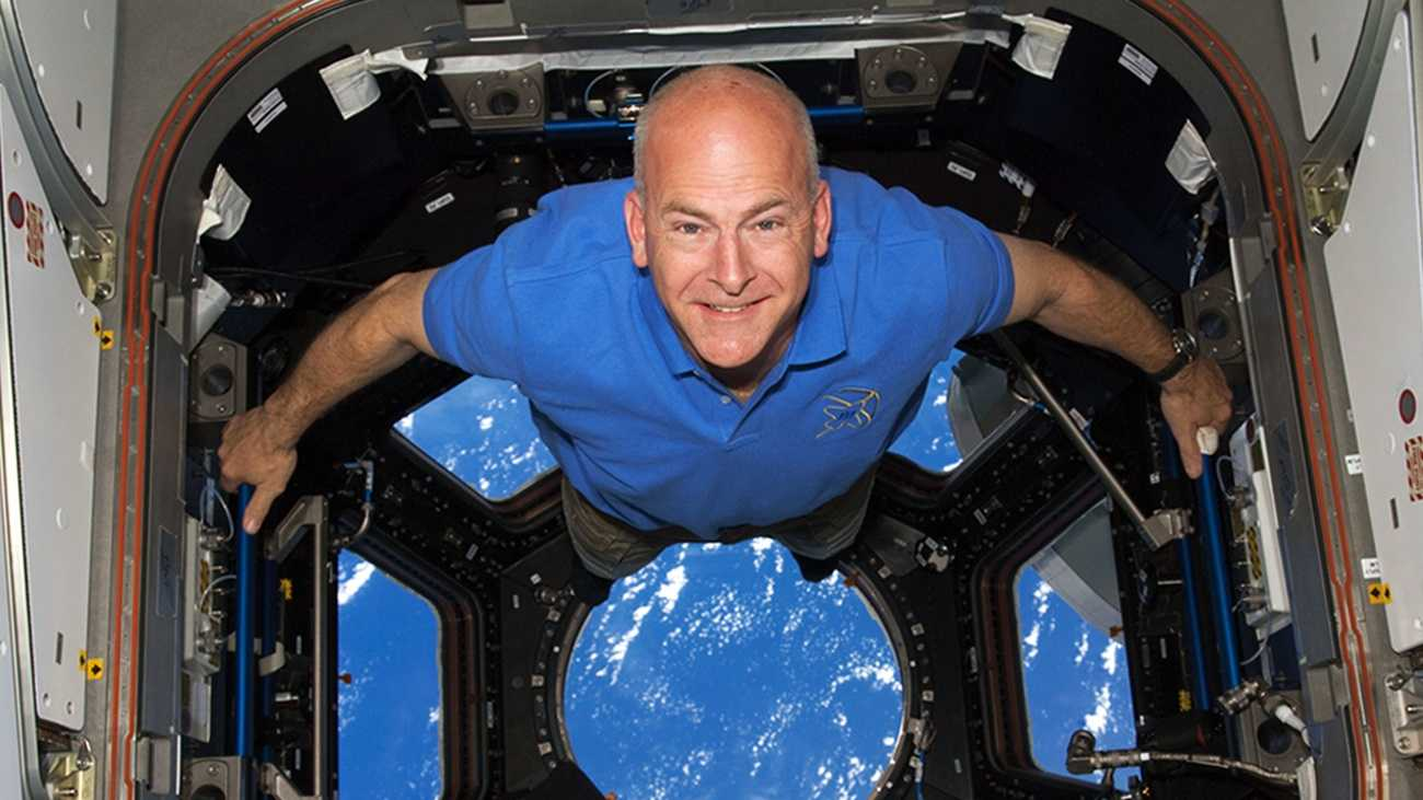 "Capt. Alan ""Dex"" Poindexter smiles inside the Cupola onboard the International Space Station during shuttle Discovery's STS-131 mission in 2010."