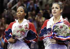 Gabby Douglas, left, and Aly Raisman are emotional after being named to the U.S. women's Olympic gymnastics team.