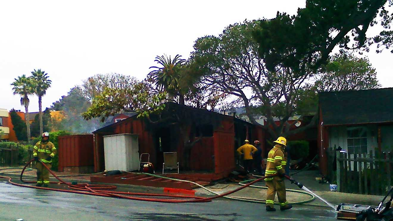 A woman died in this Monterey house fire Friday morning. (July 6, 2012)