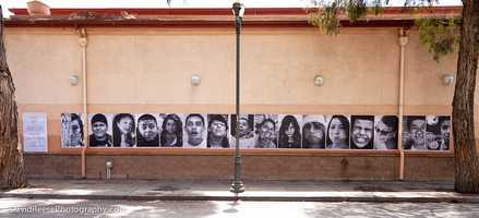 """The public art installation is titled, """"Student Portraits of Peace in Our Streets... You Only Live Once."""""""