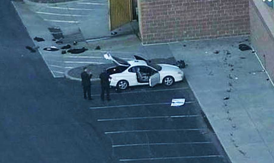 Holmes surrendered meekly and peacefully when officers found him by his white car. The car was parked outside behind the theater.