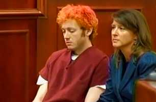 "Holmes, who identified himself to police as ""The Joker,"" gave little indication that he was paying attention to what was happening in court as he sat there with his hair dyed various shades of red. (July 23, 2012)"