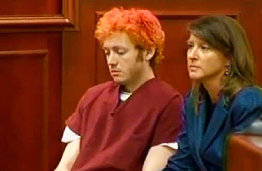 """Holmes, who identified himself to police as """"The Joker,"""" gave little indication that he was paying attention to what was happening in court as he sat there with his hair dyed various shades of red. (July 23, 2012)"""