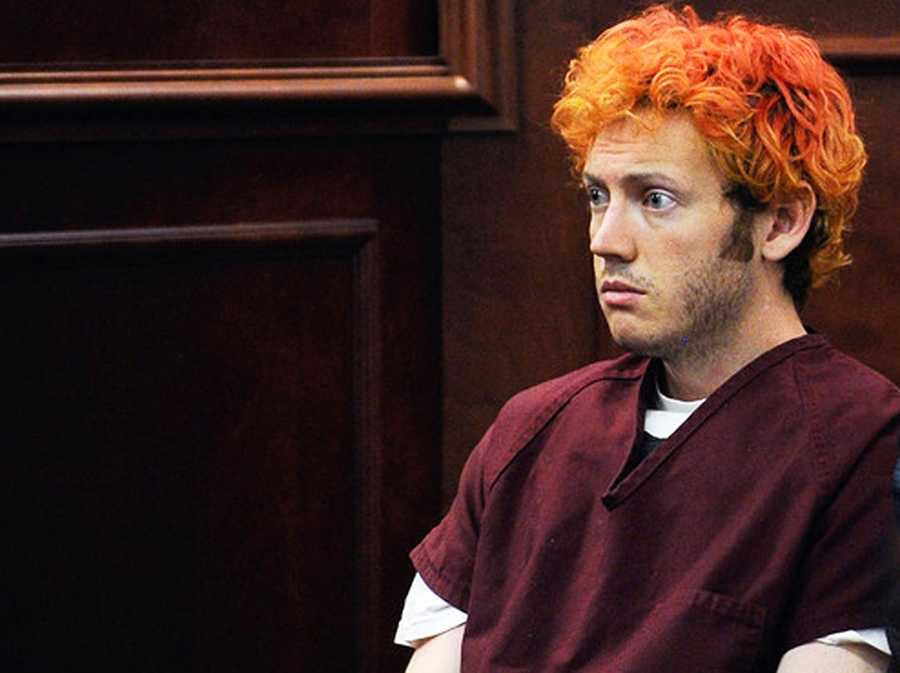 His hair dyed a shocking comic-book shade of orange-red, James Holmes showed up in court for the first time, but didn't seem to be there at all.The man accused of killing 12 moviegoers and injuring 58 others in a shooting rampage at a packed midnight screening of the new Batman film was a sleepy, seemingly inattentive suspect.