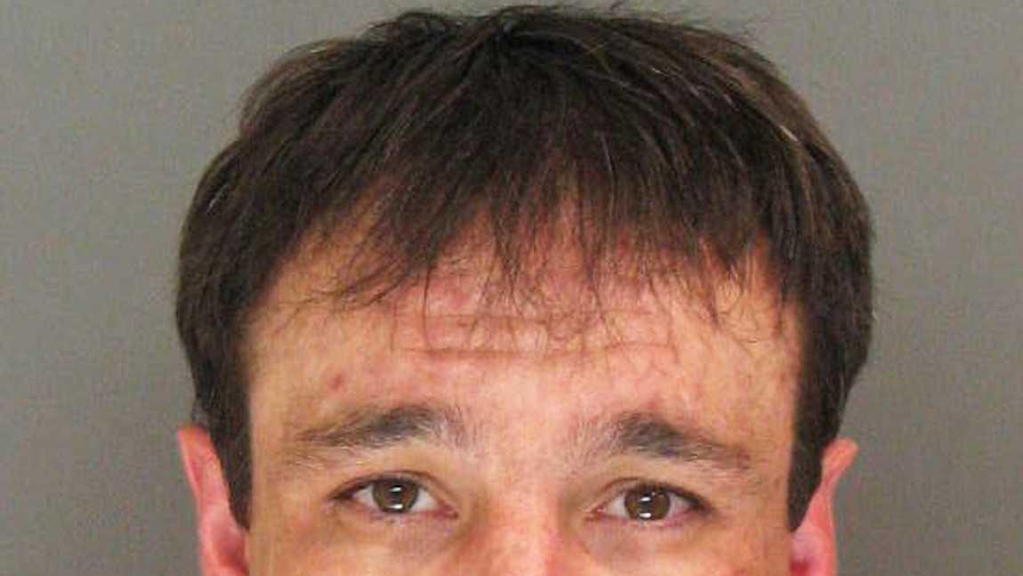 Michael Miller, 34, of Watsonville, is seen in a police mug shot.