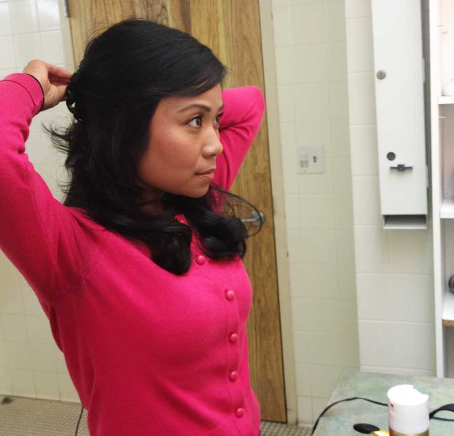 Well it's almost time to go live for the 5 p.m. news. May Chow styles her hair before going on camera.