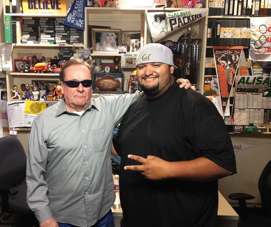 Photographer Jimmy Celaya hangs out with Dennis Lehnen in Dennis' sports office.