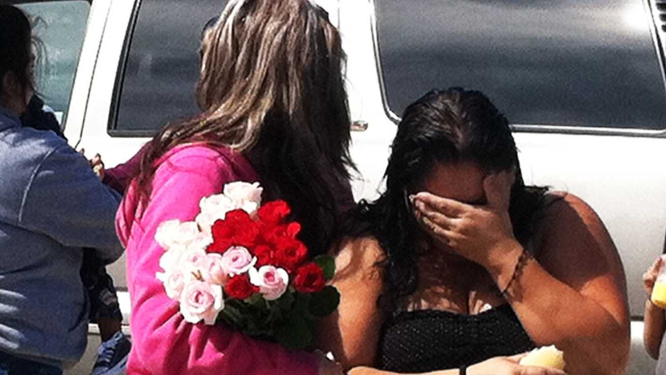 Joey Mendoza's family members are distraught the morning after the 13-year-old was slain in Santa Cruz. (Aug. 9, 2012)