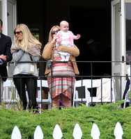 One of the youngest spectators at the Pebble Beach Concours d'Elegance 2012 waves from a VIP party.