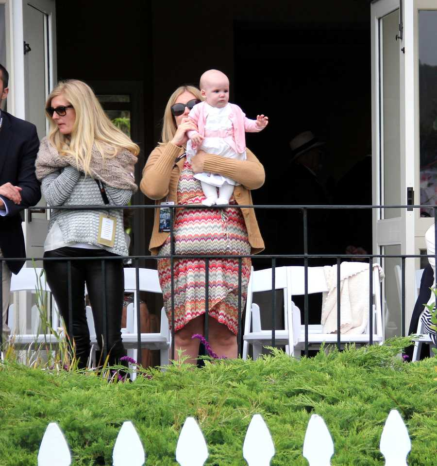 One of the youngest spectators at thePebble Beach Concours d'Elegance 2012 waves from a VIP party.