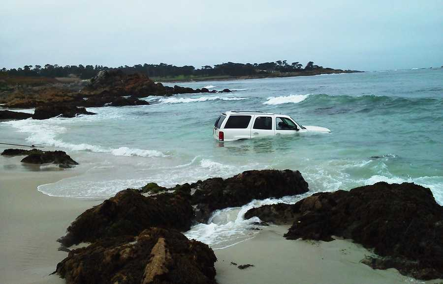 A man was driving along Pebble Beach's scenic 17 Mile Drive on Thursday when his Cadillac Escalade splashed into the ocean. (Aug. 23, 2012)