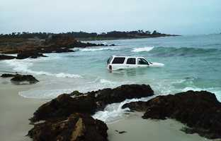 A man was driving along Pebble Beach's scenic 17 Mile Drive on Thursday morning when his Cadillac Escalade splashed into the ocean.