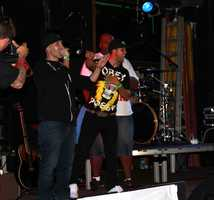 "The show was hosted by local radio station 102.5 KDON and organized by DJ Sam ""Diggedy"" Segovia, left.KDON Morning Madhouse radio hosts Segovia, Domingo Rivera, and Rynell ""Showbiz"" Williams are seen here talking to the high-energy crowd."
