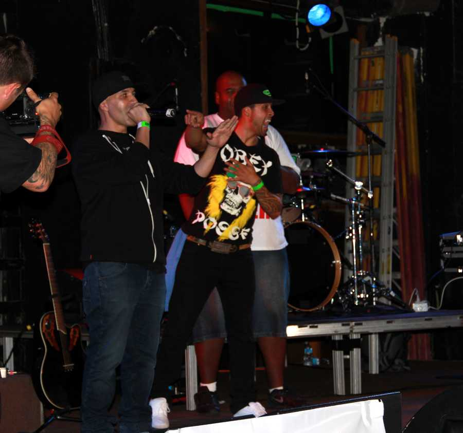 """The show was hosted by local radio station 102.5 KDON and organized by DJ Sam """"Diggedy"""" Segovia, left.KDON Morning Madhouse radio hosts Segovia, Domingo Rivera, and Rynell """"Showbiz"""" Williams are seen here talking to the high-energy crowd."""