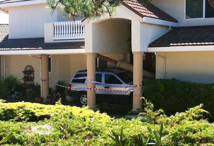 A sport utility vehicle crashed into a large Carmel house's front door and sent a large column tumbling to the ground.The driver suffered minor injuries and firefighters discovered he was also the house's owner.(Aug. 28, 2012)