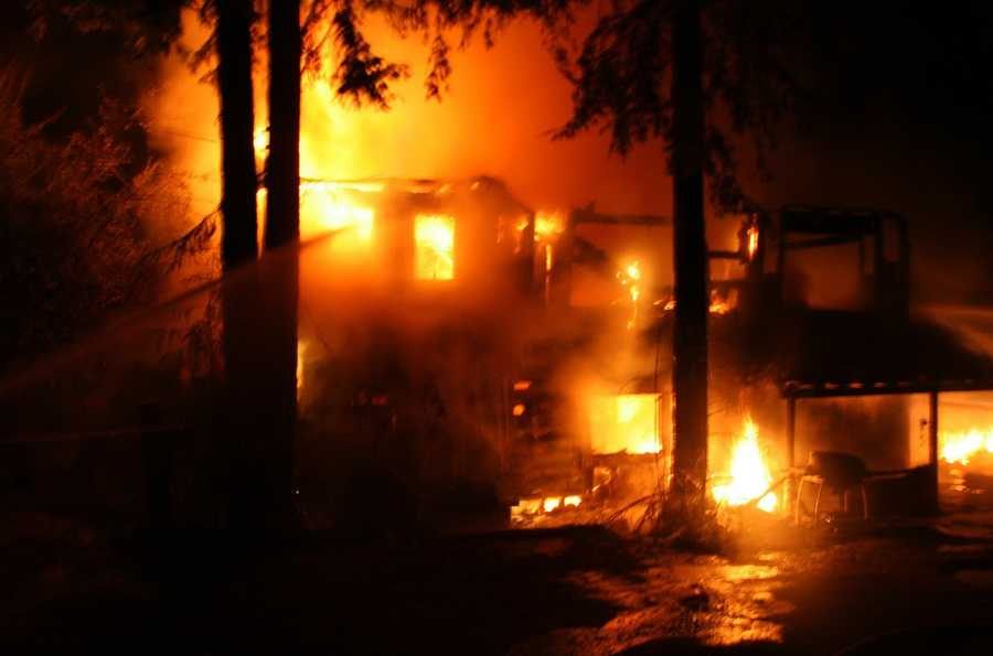 The house on Old County Highway and Highway 9 was fully engulfed by the blaze when firefighters arrived just after 7:30 p.m.